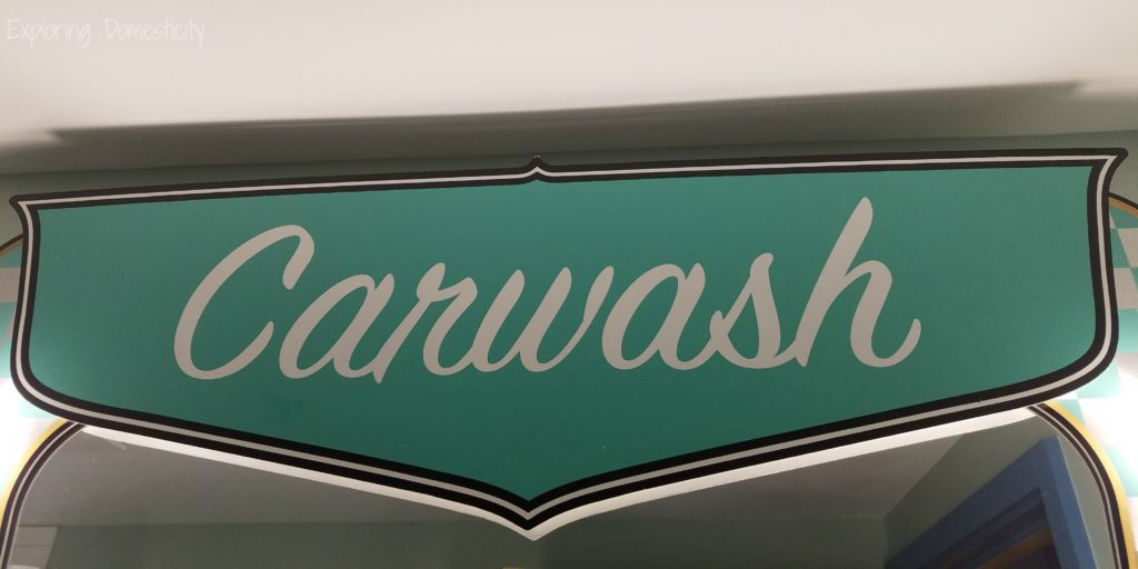 Art of Animation Cars Suites Carwash Sign
