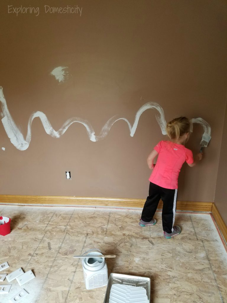 Little Lady painting the playroom - Play Room with DIY Loft bed for play space and storage