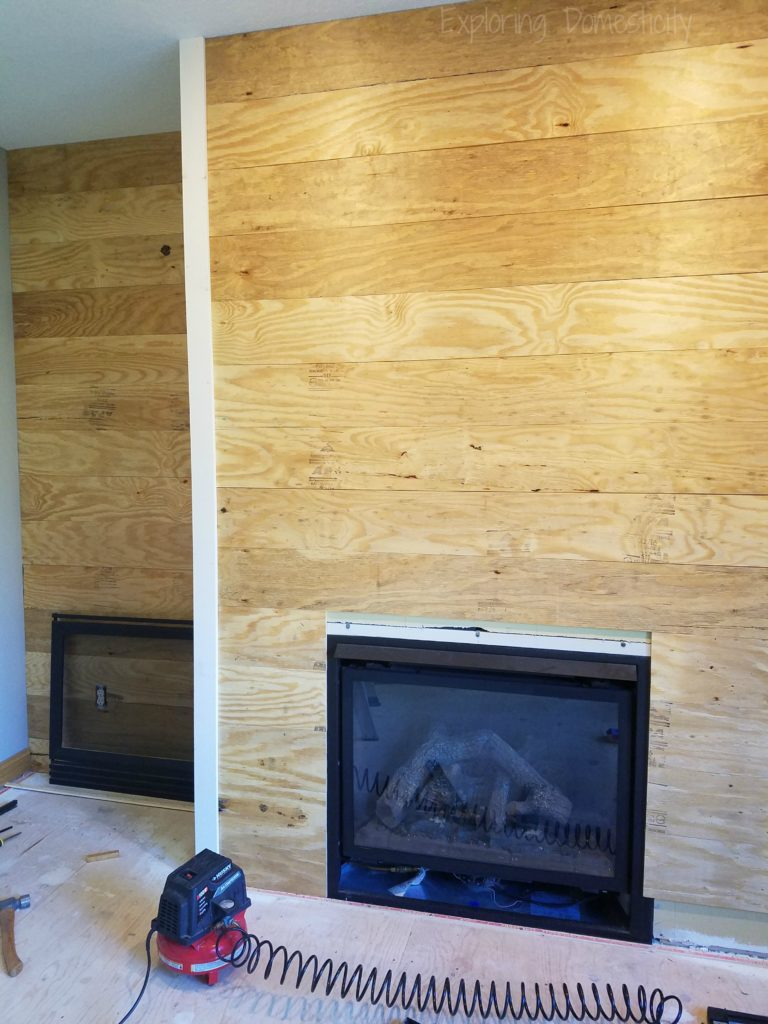 DIY Faux Shiplap Wall in progress with corners up