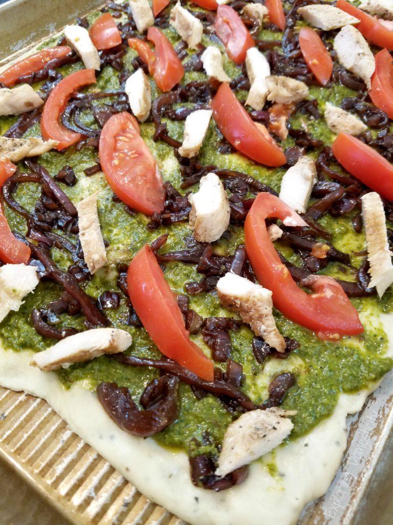 Balsamic Onion Pesto Pizza Assembly - pesto, onions, chicken, tomato, and cheese