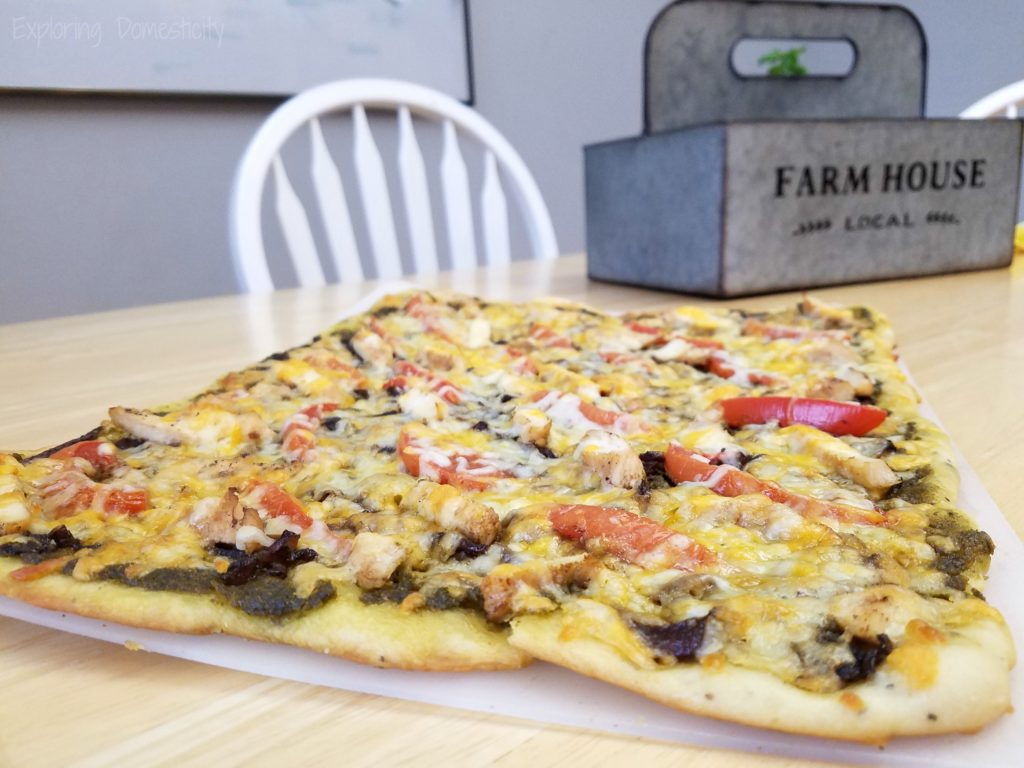 Balsamic Onion Pesto Pizza - rich pesto sauce, sweet onions, chicken, tomatoes, and Crystal Farms Cheese - SO GOOD!