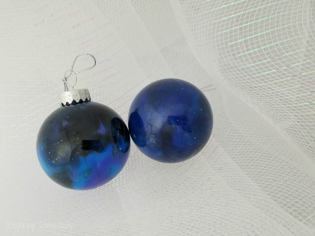 DIY Galaxy Ornaments with acrylic paint pour