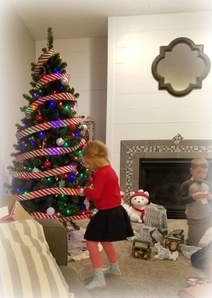 Kids decorating the Christmas tree - tips for creating memorable holiday moments
